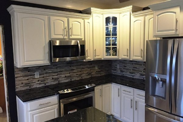 Kitchen Remodel - 365 Renovations - Montgomery, OH - White kitchen cabinets black countertop gray tiles 1140